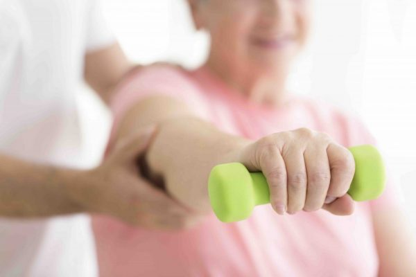 Geriatrics: Physical rehabilitation for older patients whilst the patient is holding minor dumb-bell